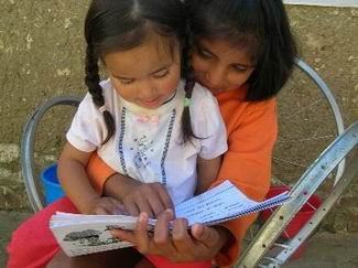 10-year old Lourdes (right) began her formal education this February and enjoys sharing what she is learning with others, like 2-year old Daniela. They both reside in Sopachuy.