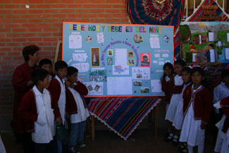 4th grade class presenting their educational poster about children